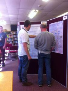 Daniel discussing his poster with Dr Ian Shannon